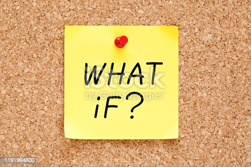 Question What If? handwritten on yellow sticky note pinned on cork bulletin board.