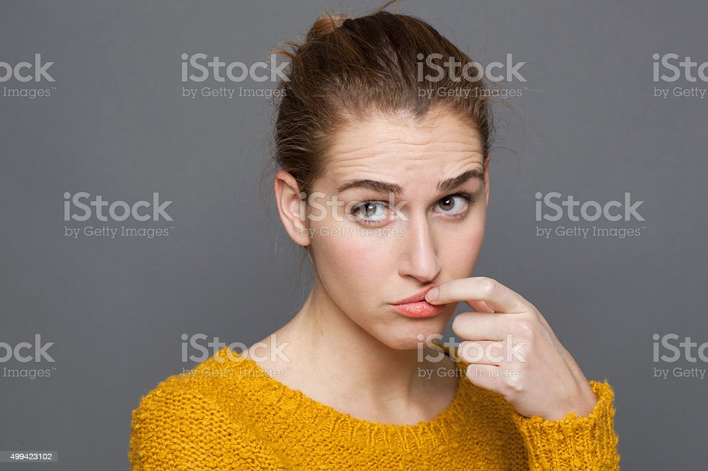 questioning young woman looking dubious,expressing confusion and distrust stock photo