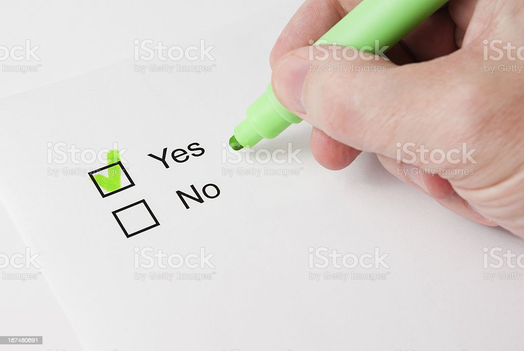Questionnaire with choices. 'Yes' box ticked by green marker. royalty-free stock photo