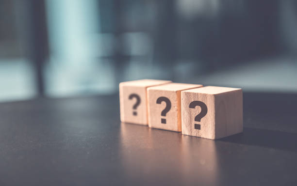 ? Questions Mark word in wooden cube block on table background. FAQ  Answer, Q&A. stock photo