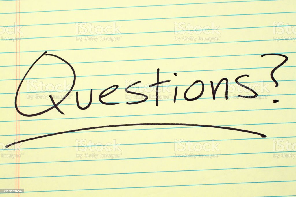 Questions? On A Yellow Legal Pad stock photo