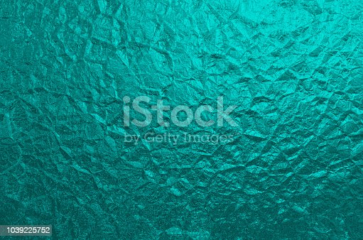 istock Quetzal Green Wrinkled Foil Texture Background Abstract Teal Pattern 1039225752
