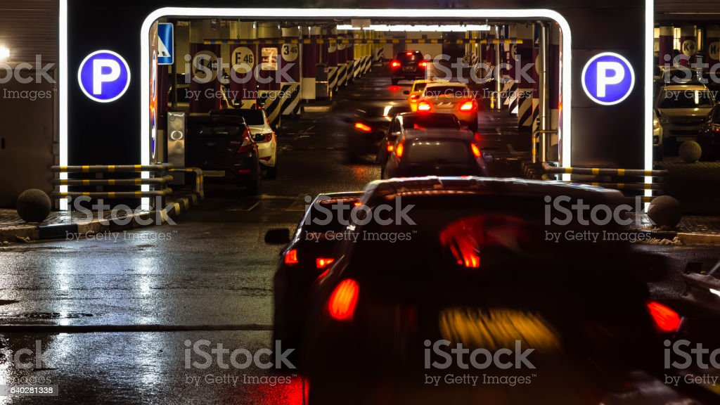 Queue of  cars at entrance of shopping mall parking stock photo