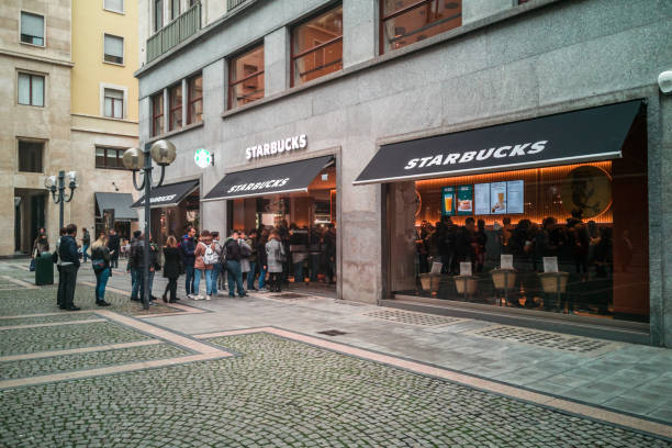 Queue of people entering in the newly open Starbucks Coffee in Turin. Turin, Piedmont, Italy, November 2019 stock photo