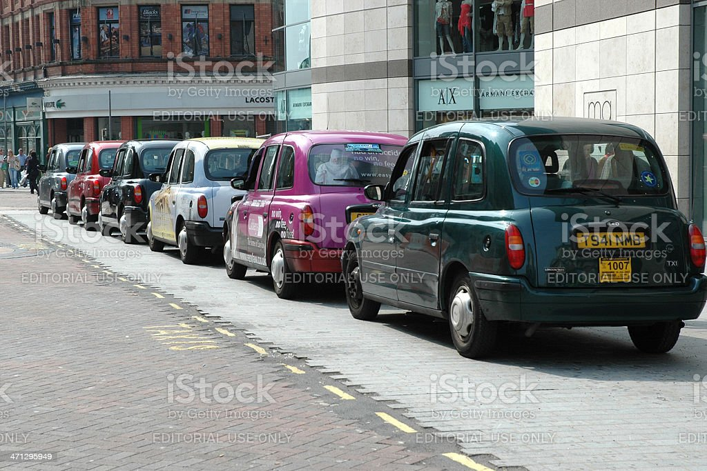 Queue of taxis waiting for passengers stock photo