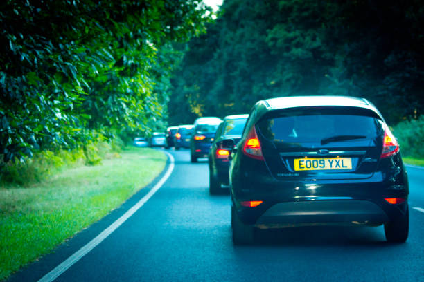 queue of traffic on the a47 - ford focus stock photos and pictures