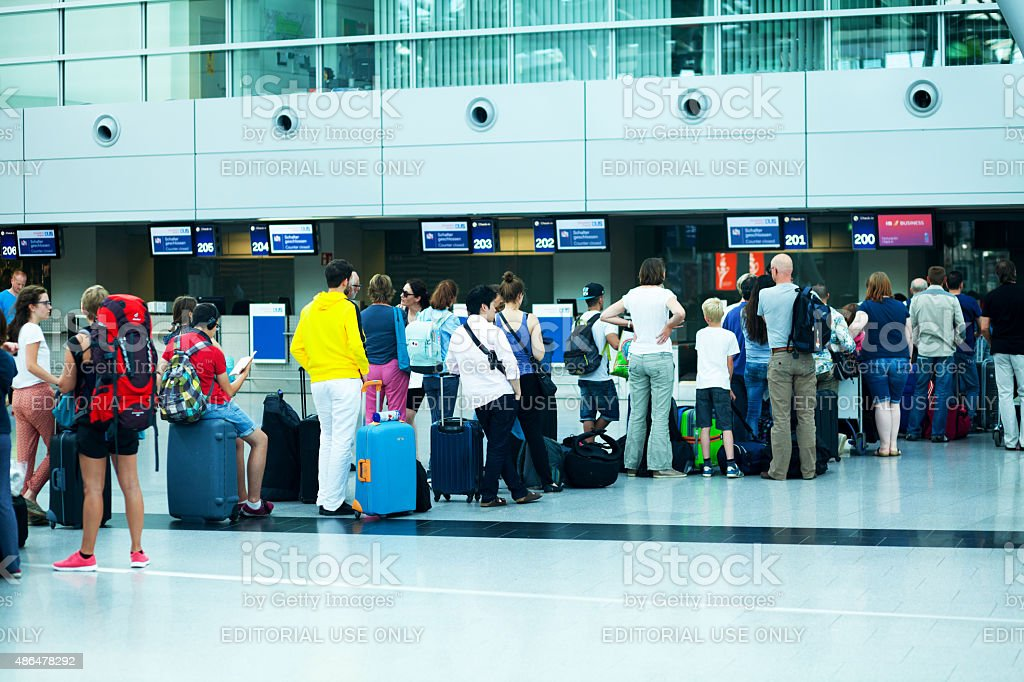 Queue of travelling people at check-in into holidays stock photo