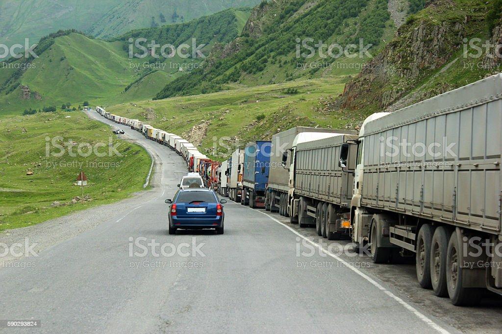 Queue of trucks waiting in line for border customs control royaltyfri bildbanksbilder