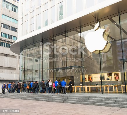 Shanghai, China - March 5, 2013: Customers waiting in a queue outside the Apple Store on East Nanjing Road in central Shanghai.