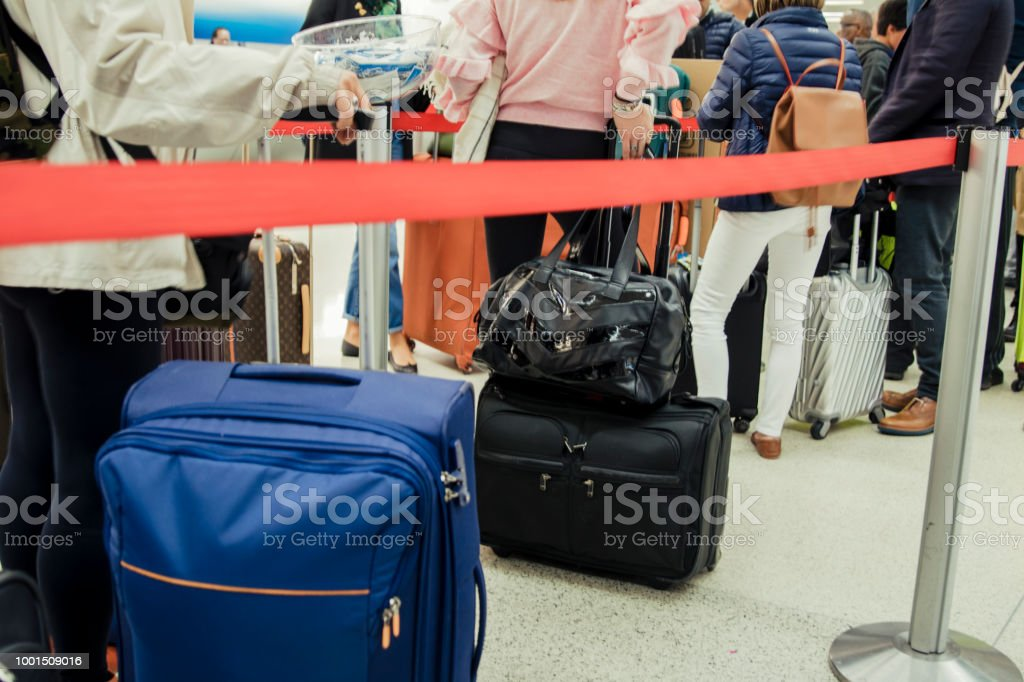 Queues Waiting To Check-in At An Airport, Anonymous People With Luggage stock photo