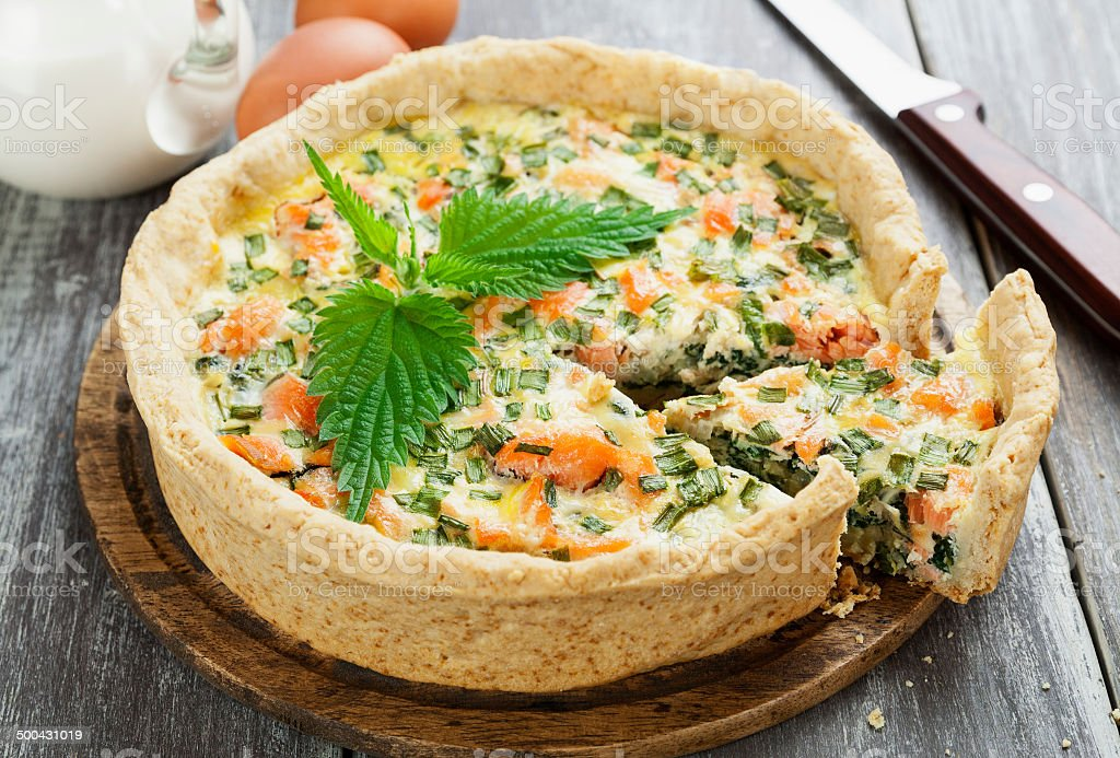 Quiche pie with fish and nettles stock photo