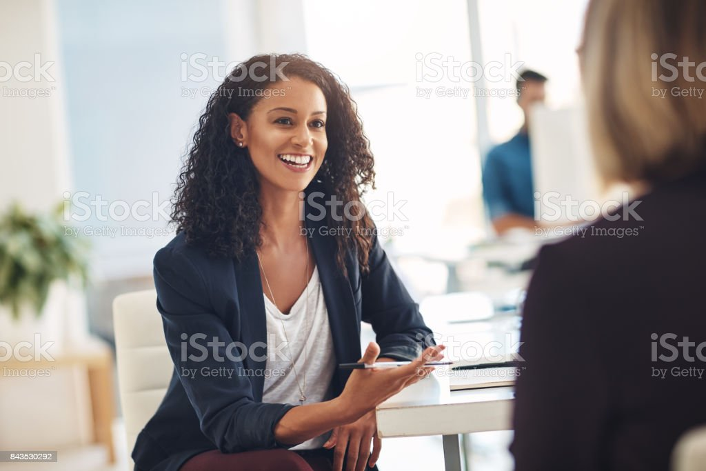 Quick catch up with a coworker stock photo