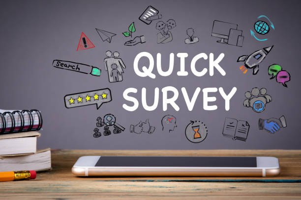 quick survey, Media Technology concept quick survey, Media Technology concept. Mobile phone on a wooden table and a gray background survey stock pictures, royalty-free photos & images