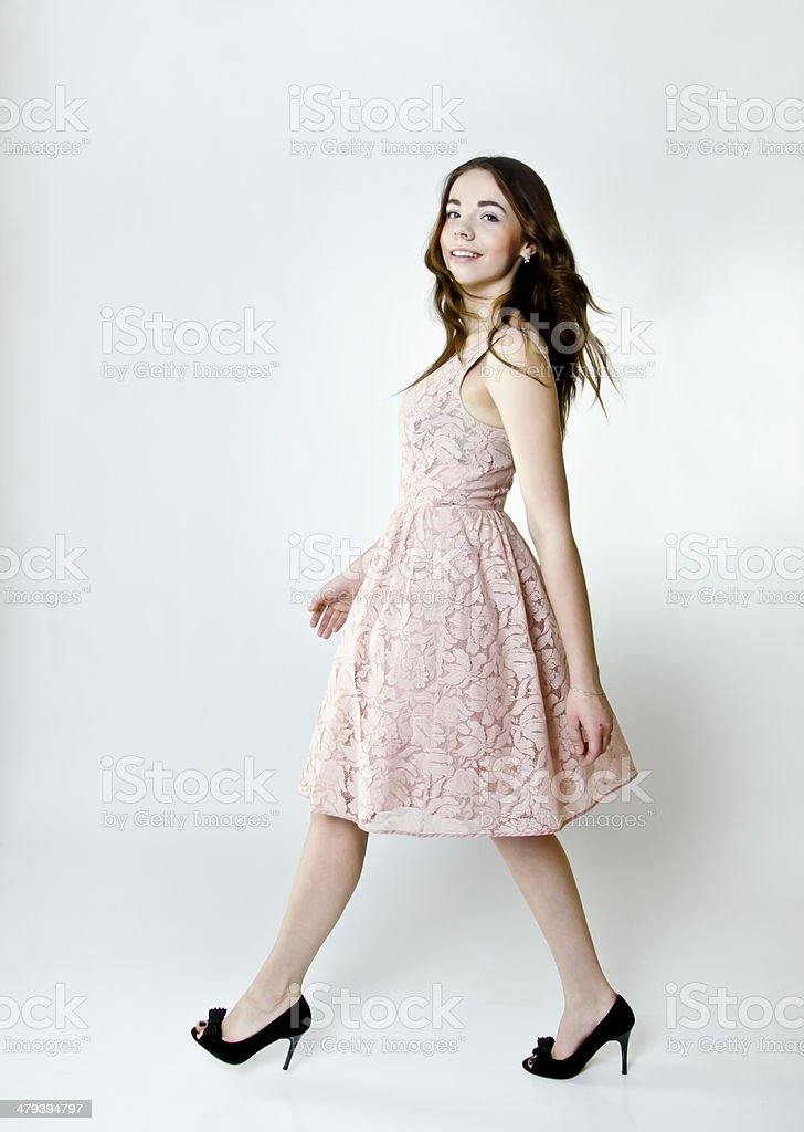 Quick walking pretty young woman. stock photo