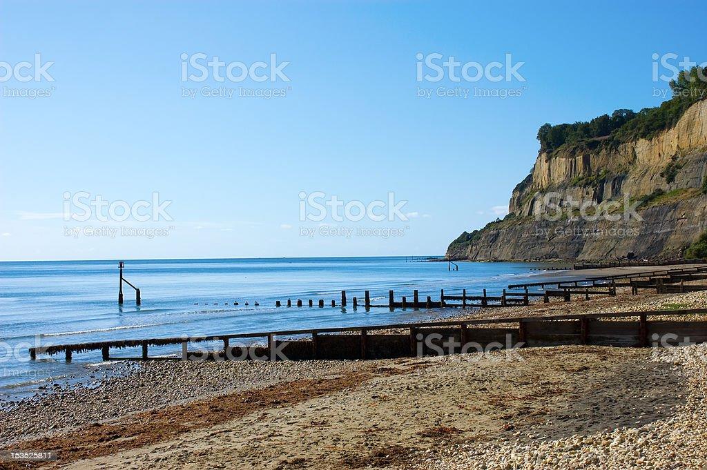 Quiet Beach below Cliffs stock photo