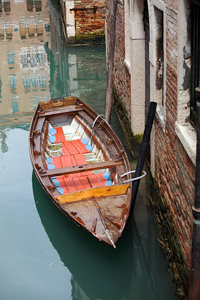 Quiet Canal in Venice with Boat stock photo