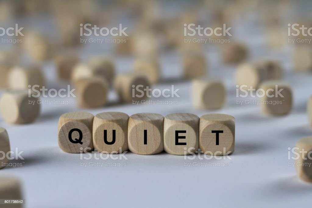 quiet - cube with letters, sign with wooden cubes stock photo
