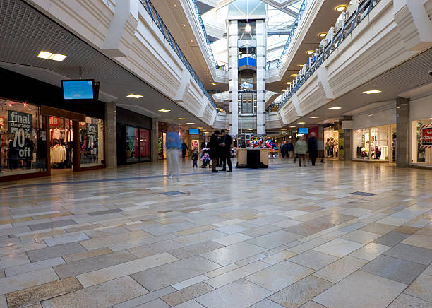 quiet day at the mall - shopping mall stock photos and pictures