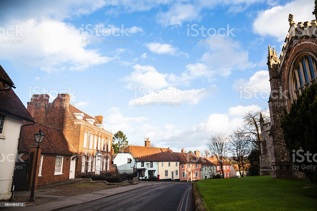 quiet essex village street church and houses in winter sun stock photo