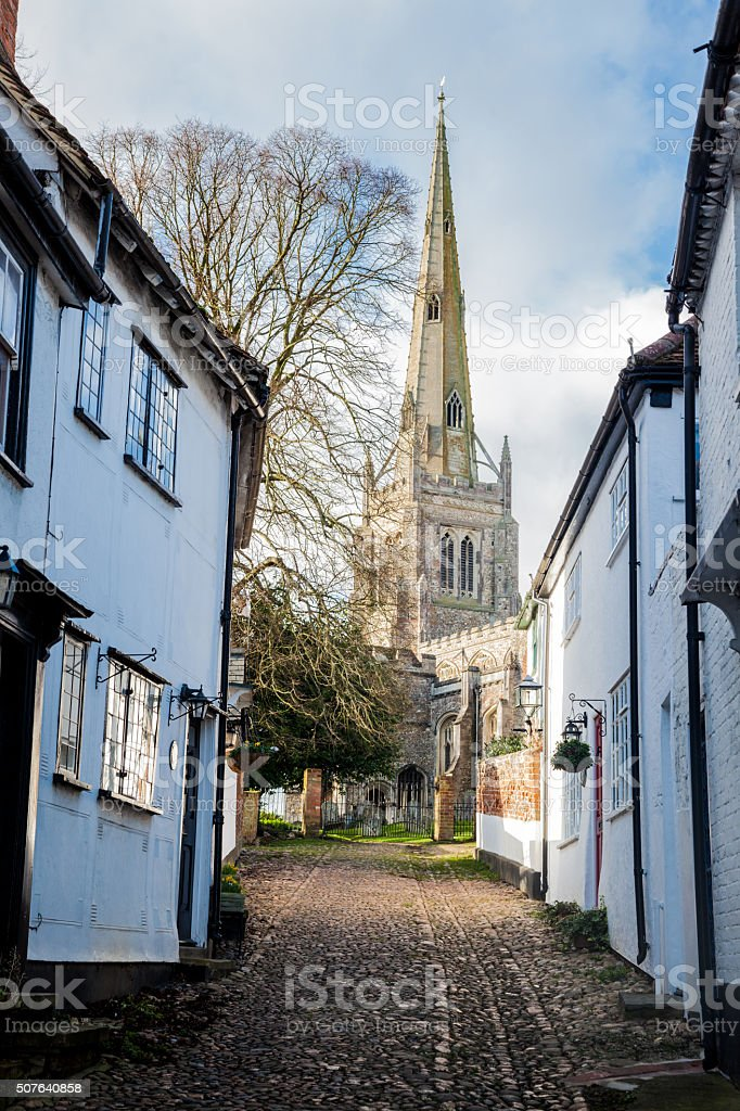 quiet essex village street houses and church in winter sun stock photo