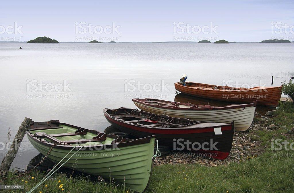 Quiet lake and rowboats royalty-free stock photo