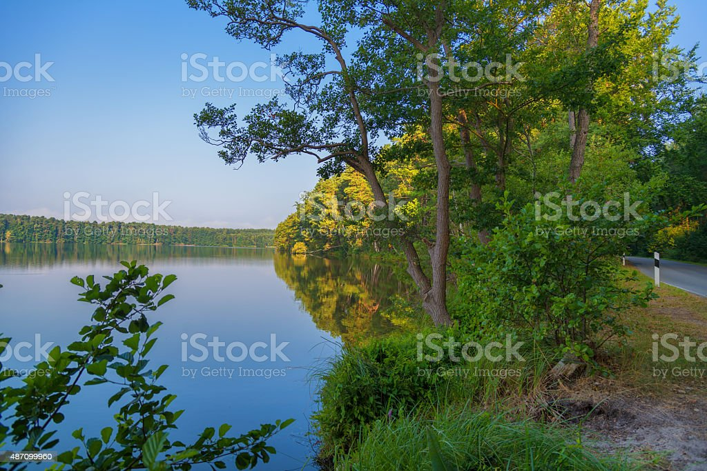 quiet lake and street in morning light - Mecklenburg Germany stock photo