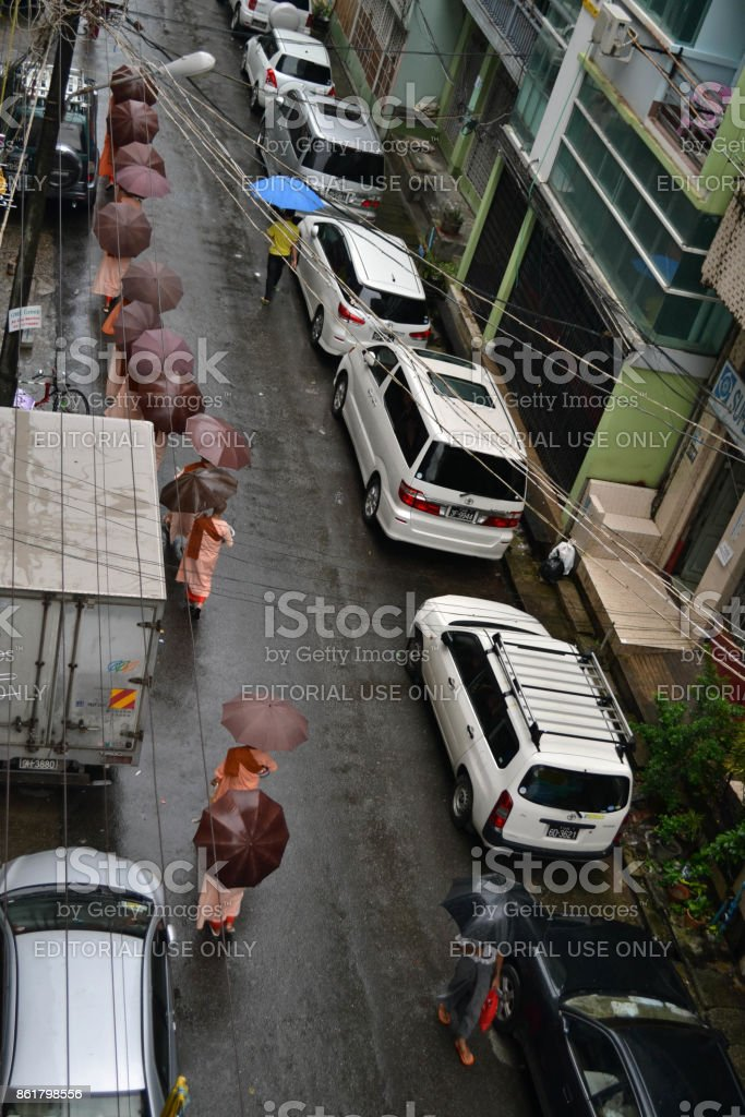 Quiet morning in Yangon, Burma. Some people already started their day, including monks asking for alms stock photo