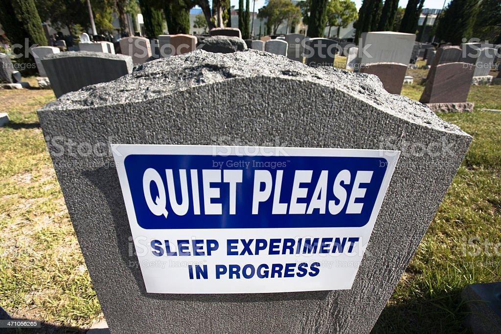 'Quiet Please' sign on gravestone in cemetery stock photo