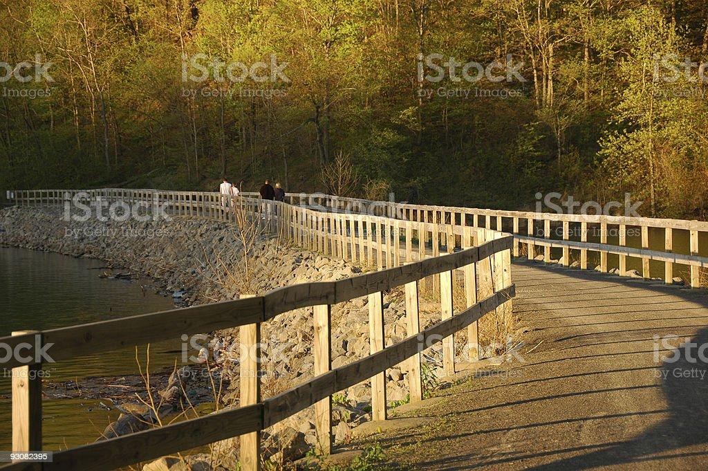 Quiet stroll on the bridge stock photo