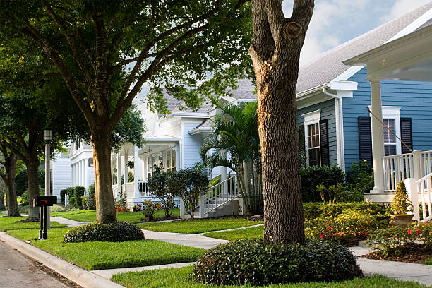 Quiet, suburban street in a small town  new urbanism - neighborhood street scene in small American town southern usa stock pictures, royalty-free photos & images