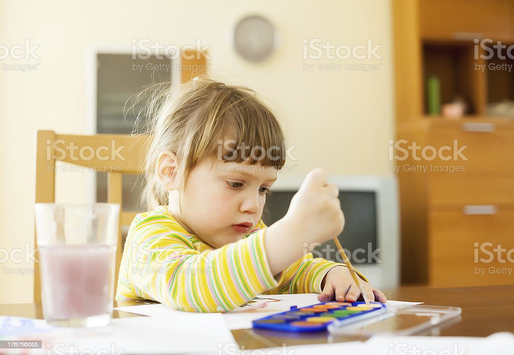 quiet two year child painting  with watercolor royalty-free stock photo