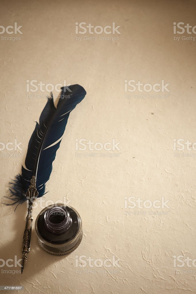 Quil pen and Inkwell stock photo