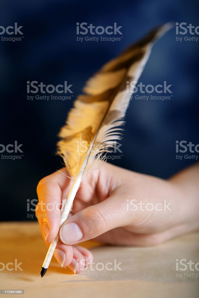 Quill in a hand royalty-free stock photo