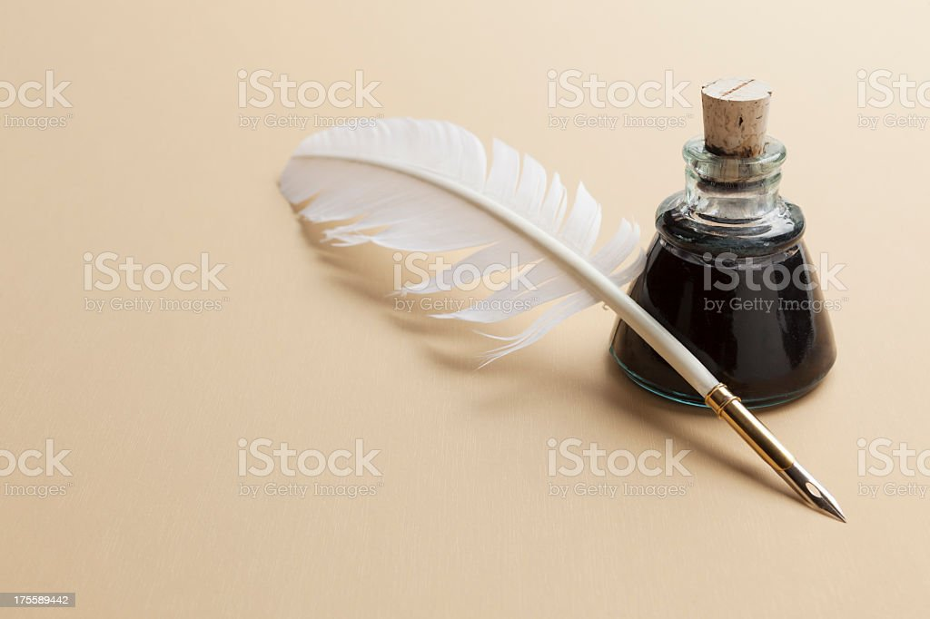 Quill pen and ink bottle stock photo