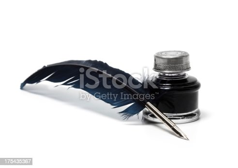 Quill pen and inkwell isolated on white.