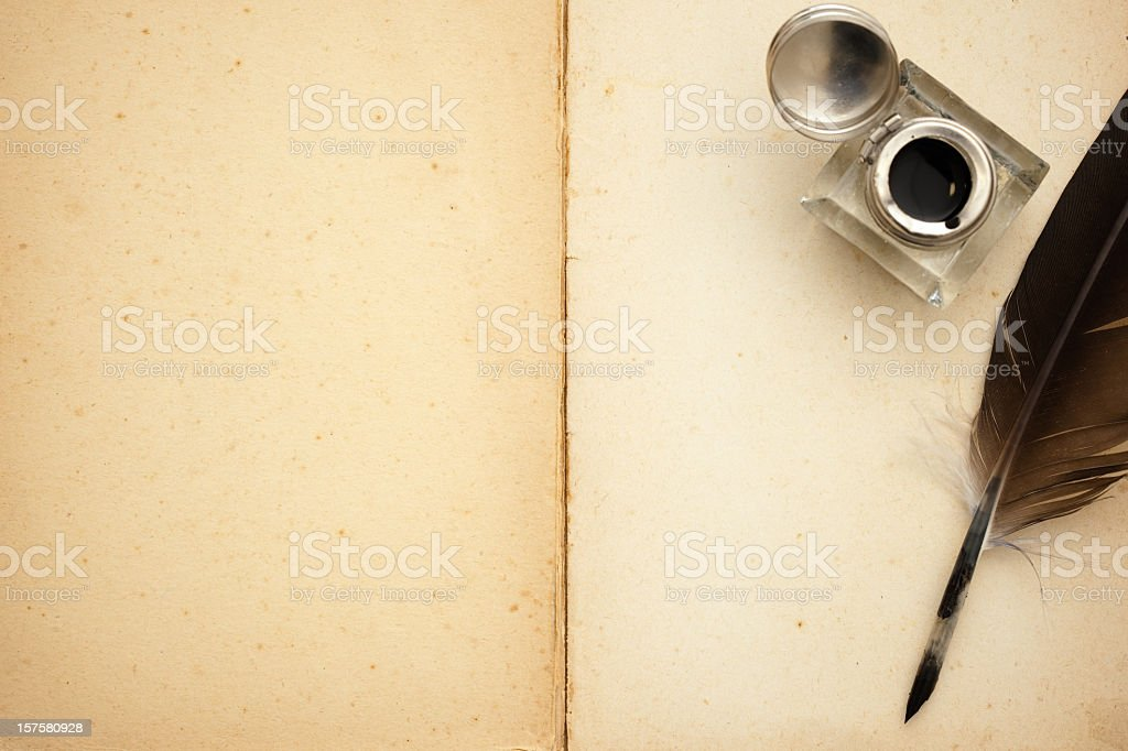 Quill pen and old book stock photo