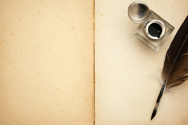 quill pen and old book - ink well stock photos and pictures