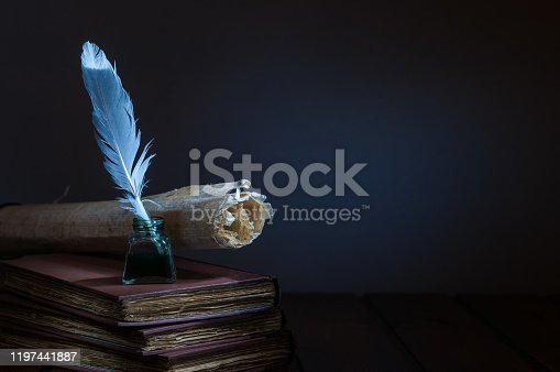 1055062454 istock photo QUIll pen and old books 1197441887