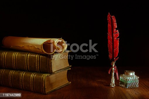 1055062454 istock photo QUIll pen and old books 1197442989
