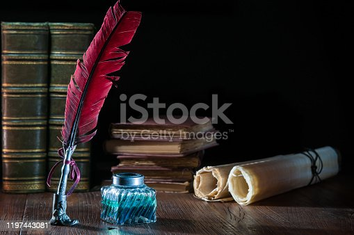 1055062454 istock photo QUIll pen and old books 1197443081