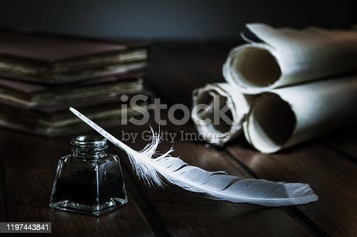 1055062454 istock photo QUIll pen and old books 1197443841