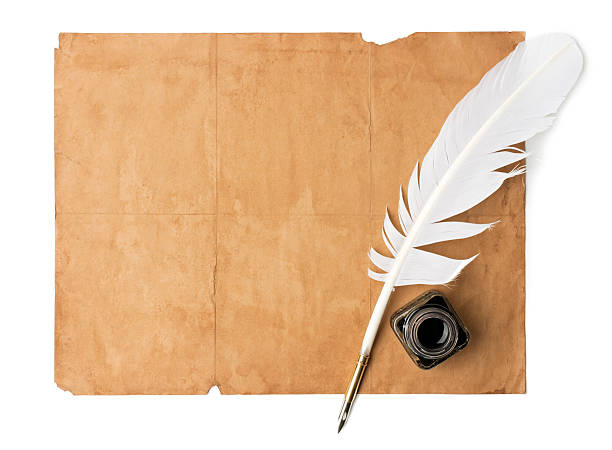 Quill pen and old paper stock photo