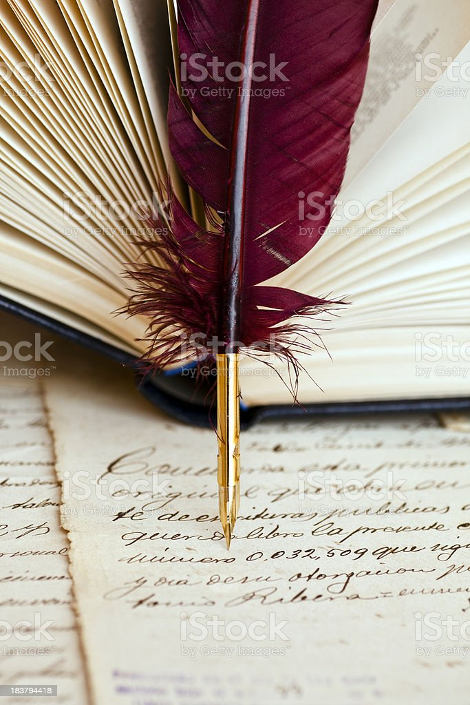 Quill pen and parchment royalty-free stock photo