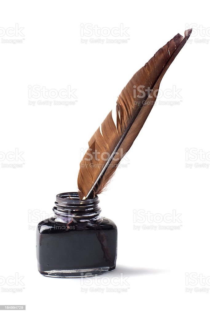 Quill pen in inkwell stock photo