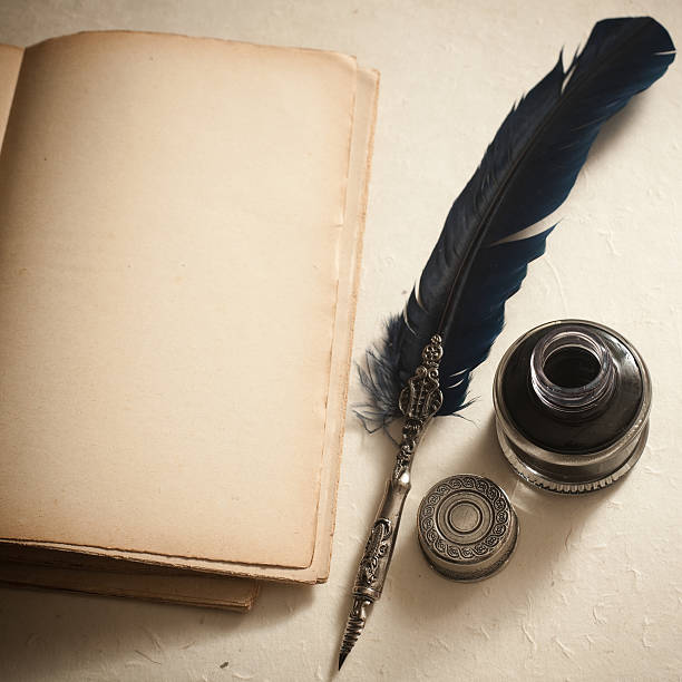 quill pen, inkwell  and old book - ink well stock photos and pictures