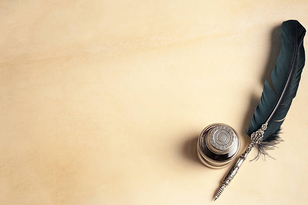 quill pen on parchment - ink well stock photos and pictures
