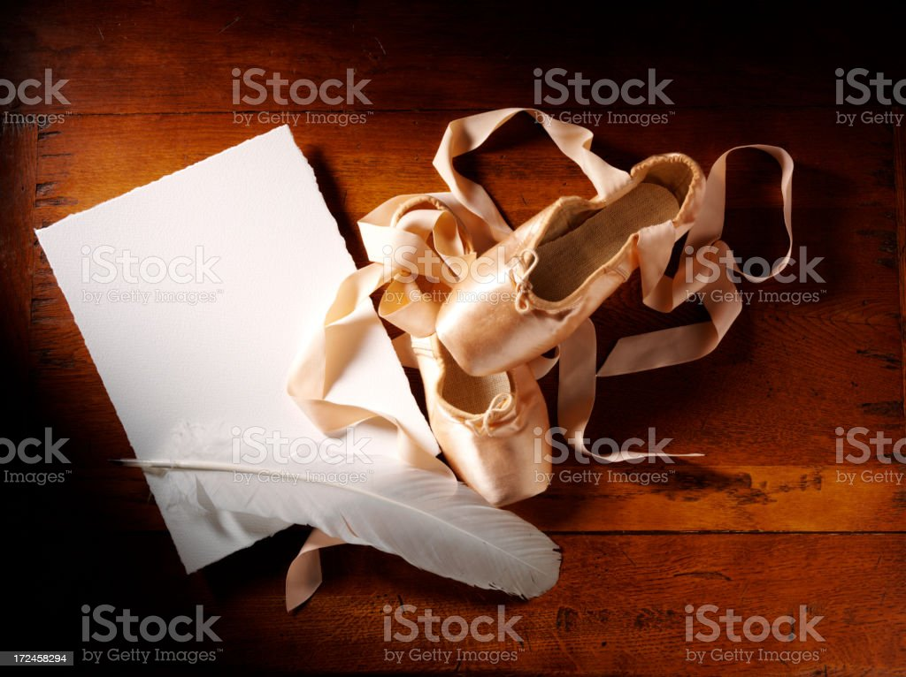 Quill Pen with Satin Ballet Shoes royalty-free stock photo