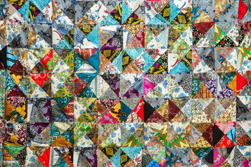 Quilt with distinct color abstract patterns, handmade domestic production stock photo