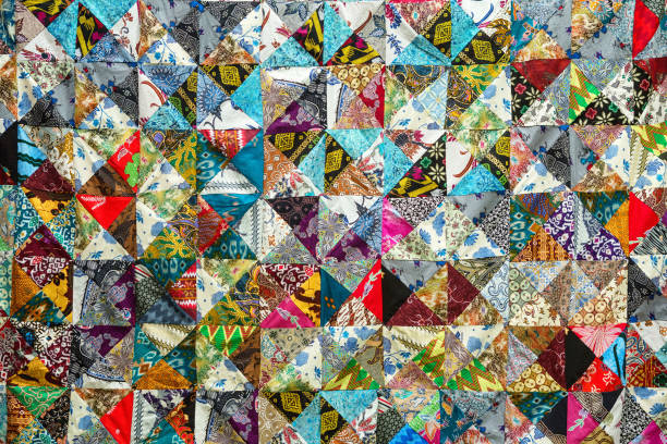 quilt with distinct color abstract patterns, handmade domestic production - quilt stock photos and pictures