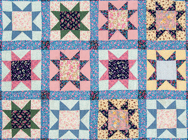 quilt with star motives - quilt stock photos and pictures